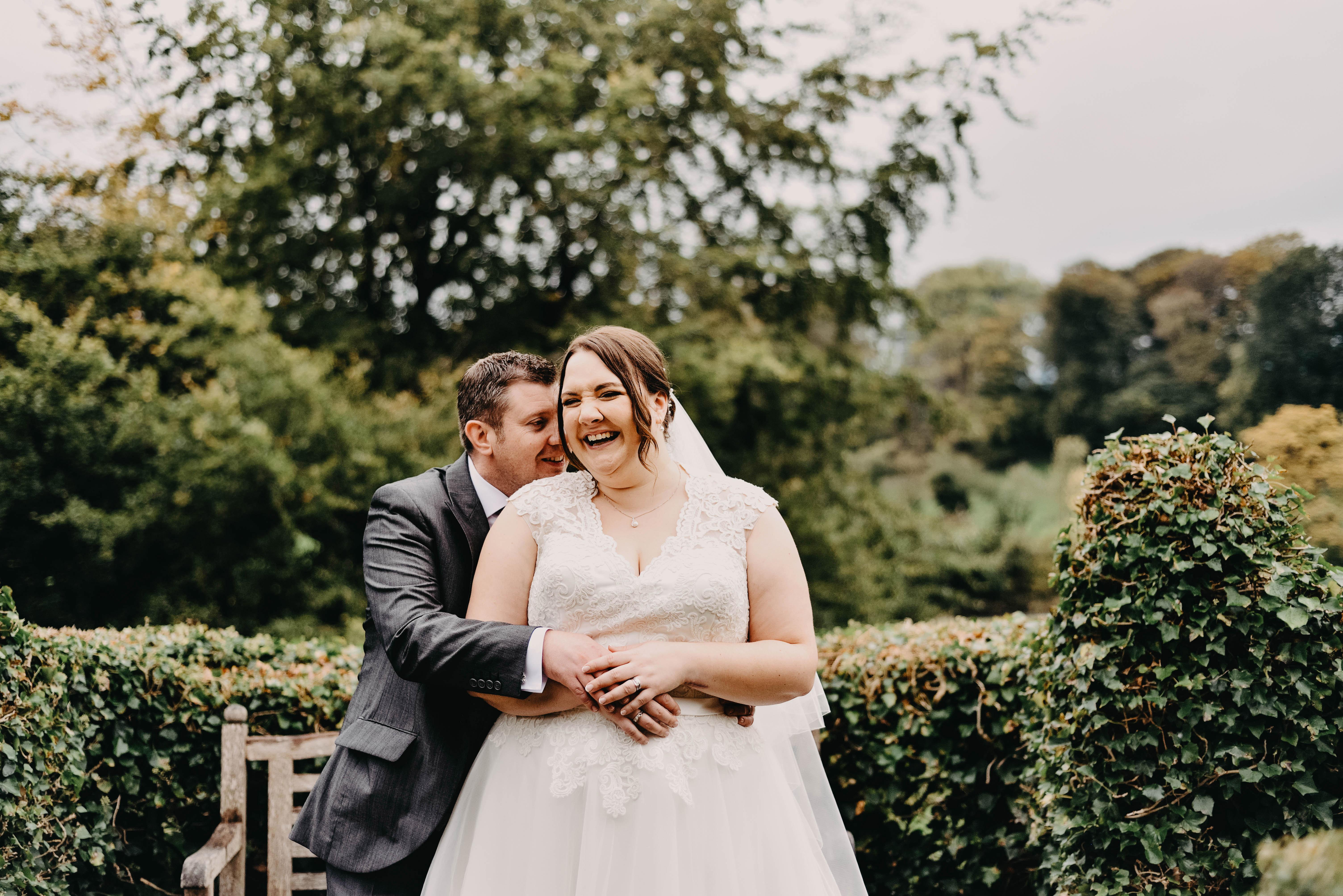 bride and groom hug and giggle