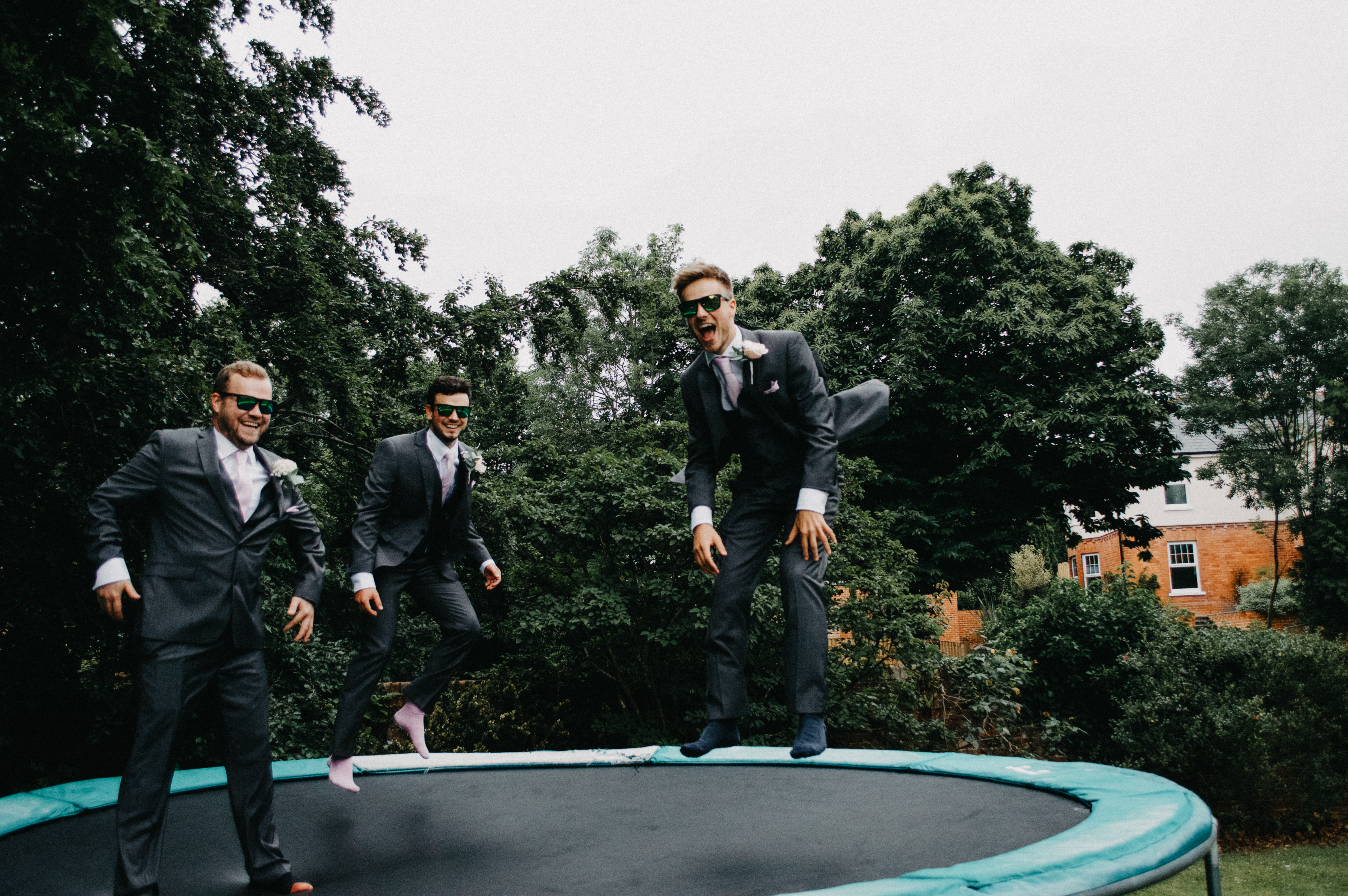 groom bouncing on a trampoline