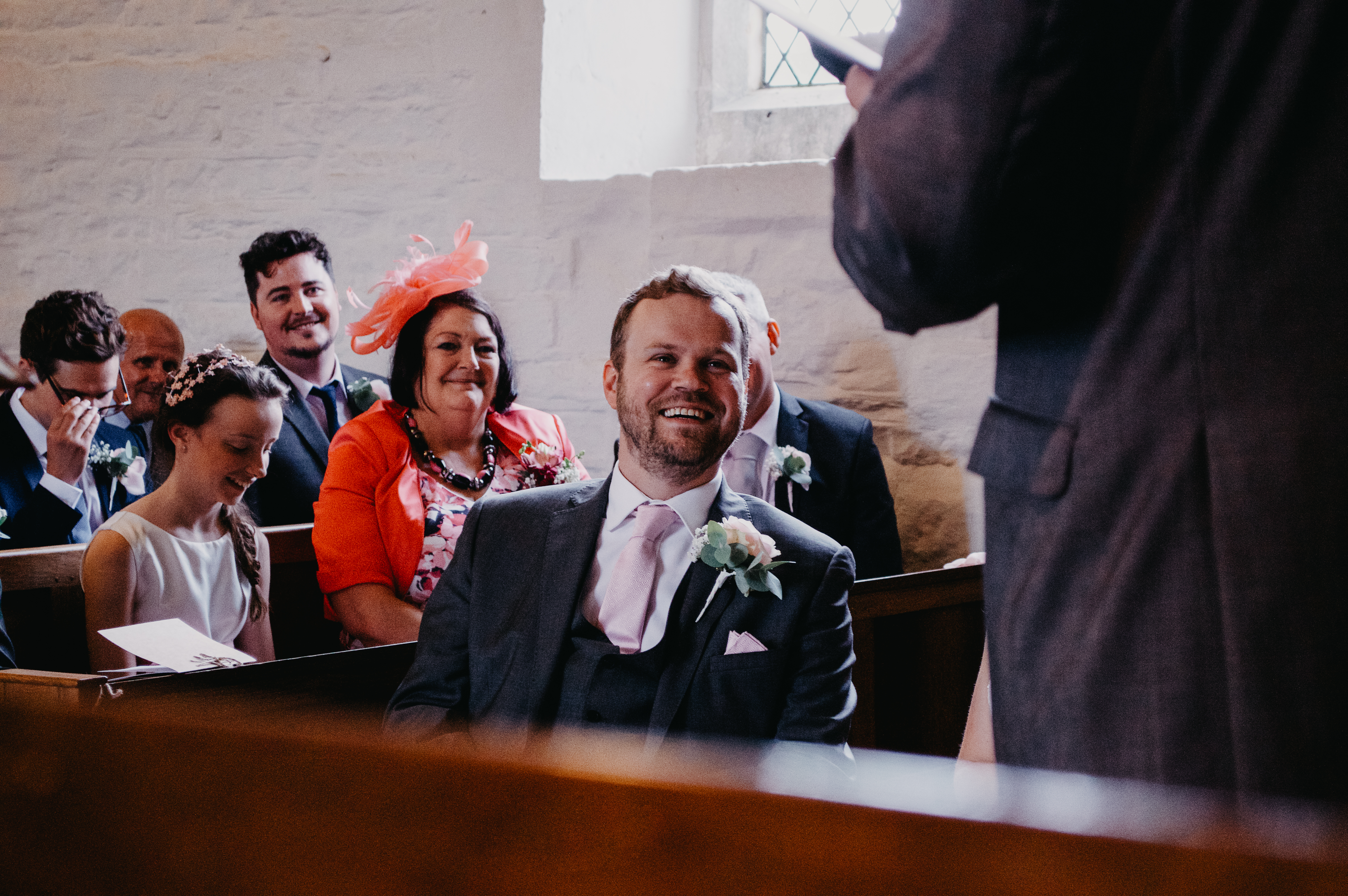 groom sitting down and laughing